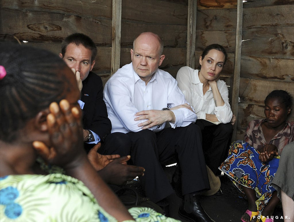 Angelina Jolie was joined by Britain's Foreign Secretary William Hague today when she visited victims of sexual violence in the Democratic Republic of Congo. She and William are touring the DRC and Rwanda to raise awareness about rape in war zones. Angie was with William today when he announced that the UK will be donating over $300,000 toward the Physicians for Human Rights in an effort to create a better method of collecting evidence of sexual violence in these areas. Unfortunately, the two couldn't visit Panzi Hospital, where the charity group works out of, due to bad weather, but they did meet with other survivors at a refugee camp. Angelina and William also laid wreaths at the Gisozi genocide memorial in Kigali, Rwanda, during their charitable travels.  While Angelina is in the spotlight for her philanthropic work, she's also turning heads with a new piece of jewelry. Angelina wore a gold band on her ring finger, instead of her diamond engagement ring, as she caught a flight out of LAX last week.