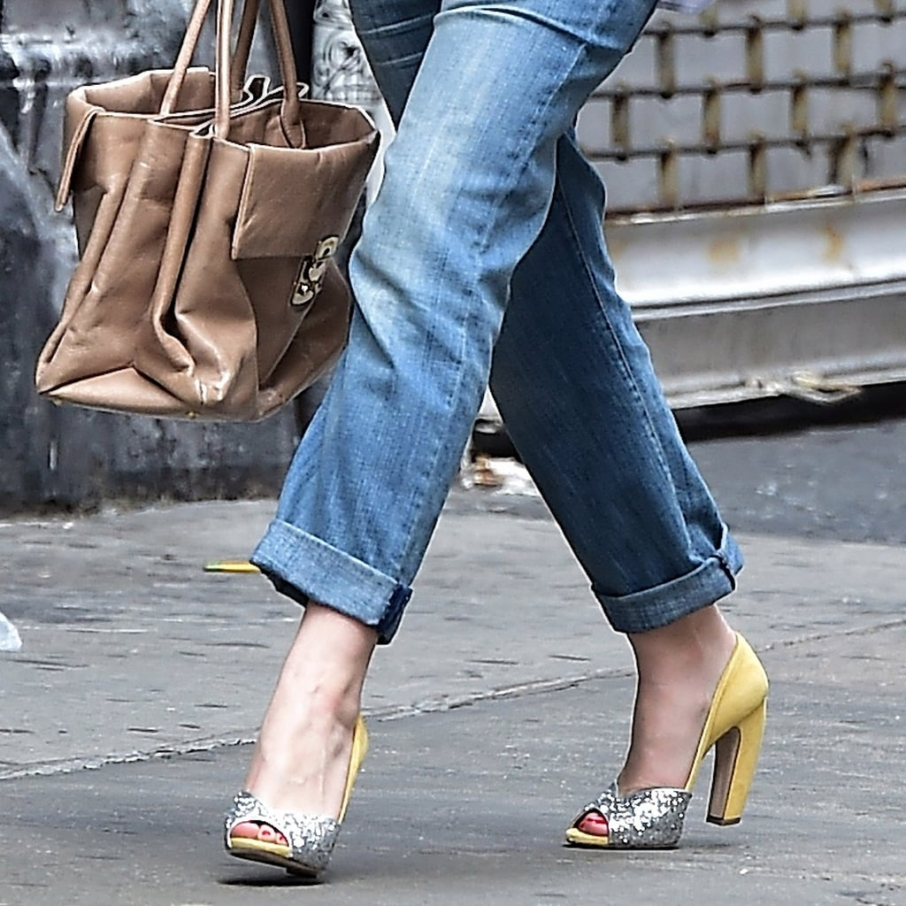 We also admire that she went with the two-toned version of this pump. A full-on glitter shoe would have been overkill, and this bright yellow (though, any color would have worked here) popped while still playing nicely next to her loose denim.