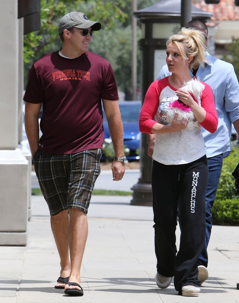"""Britney Spears and her boyfriend, David Lucado, were out in LA yesterday. The singer cradled one of her precious pups during the outing as David admired her nurturing interaction. In a recent interview, Britney said she wants more kids, preferably a little girl to even out her home base with sons Sean Preston and Jayden James Federline.  Britney's dream of a baby girl may be on hold, though, since she will be hitting the recording studio hard starting next week. On Wednesday, Will.i.am confirmed that he is the executive producer on Britney's eighth studio album and that their upcoming studio sessions are an extension of their longtime """"bonding."""" He went on to say he has never worked with anyone in such a close and trusting environment, including The Black Eyed Peas. In the meantime, Will.i.am is headed to Las Vegas to perform at Sunday's Billboard Music Awards, while Britney is headlining her own Sin City show at Planet Hollywood starting in the Fall."""