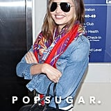 Miranda Kerr smiled as she caught a flight out of LAX.