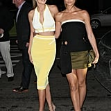 Hanging with model pal Lily Aldridge, Gigi showed off her midriff in a bright two-piece set.