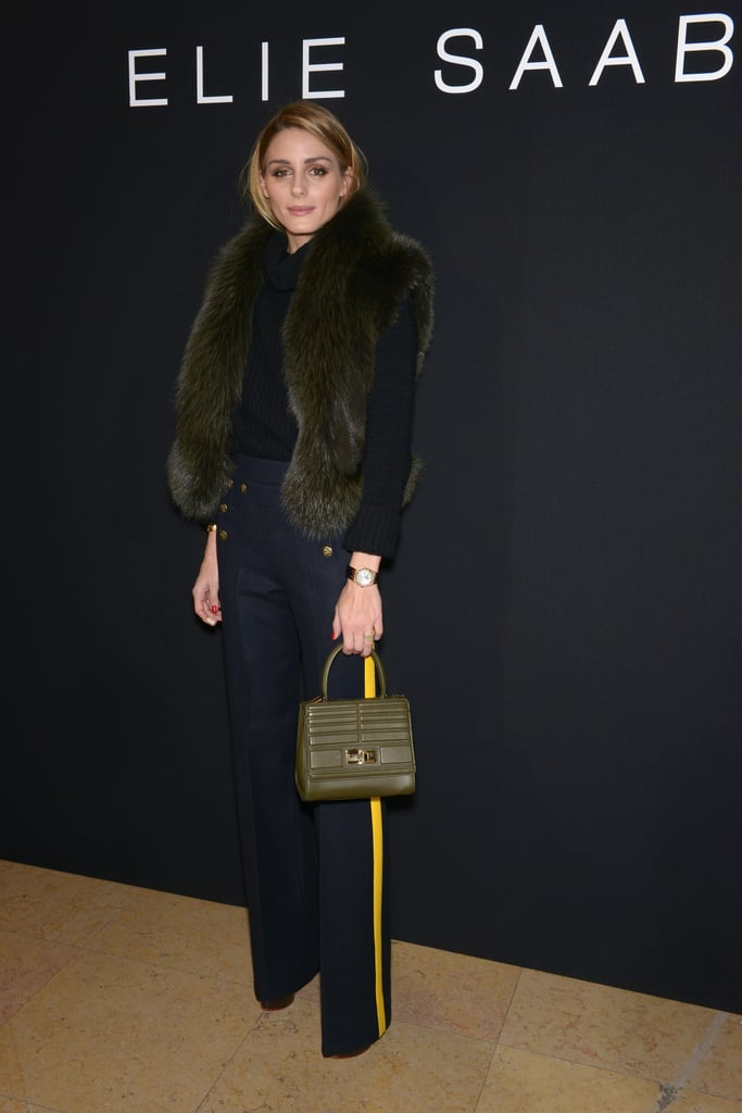 She still kept things fairly feminine though, toting around a small top-handle bag.
