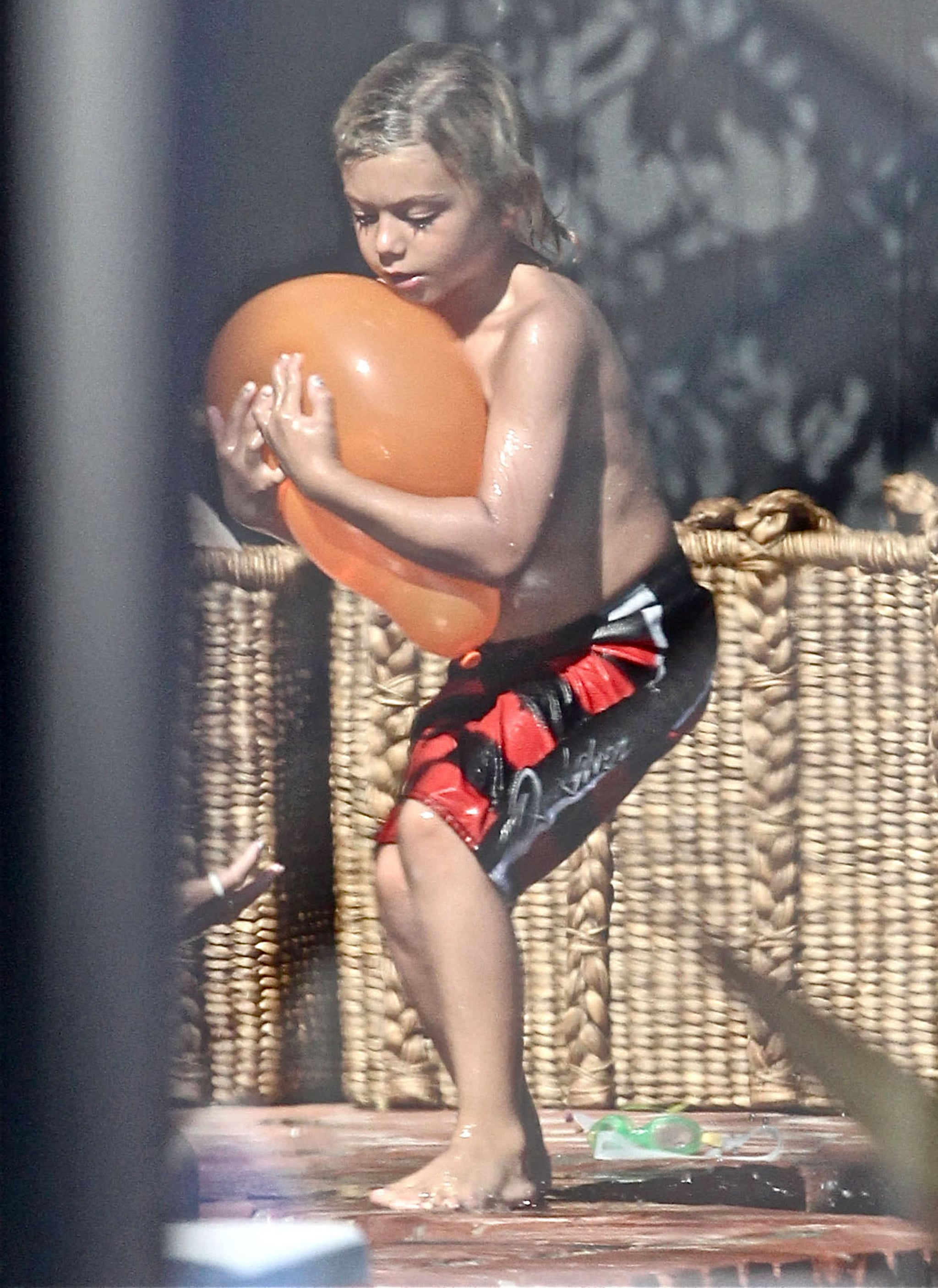 Kingston Rossdale played with water balloons at a Memorial Day party at Joel Silver's house in LA.