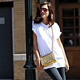 A metallic gold Chanel bag highlights the reflective lenses of statement sunglasses.