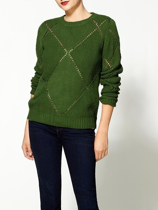 We envision this rich shade of kelly green — courtesy of an Aryn K diamond pullover ($59, originally $79) — as Fall perfect with a classic plaid button-up underneath.