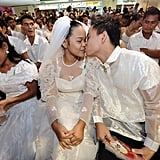 Newly married couple Rolando and Veronica kiss each other during a mass wedding as part of Valentine's Day celebrations at a shopping mall in suburban Manila.