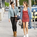 Behati wore her favorite denim duster with a striped minidress during an afternoon with Lily Aldridge.