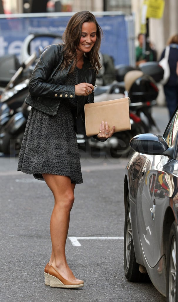 Pippa Middleton smiles as she leaves work in London.