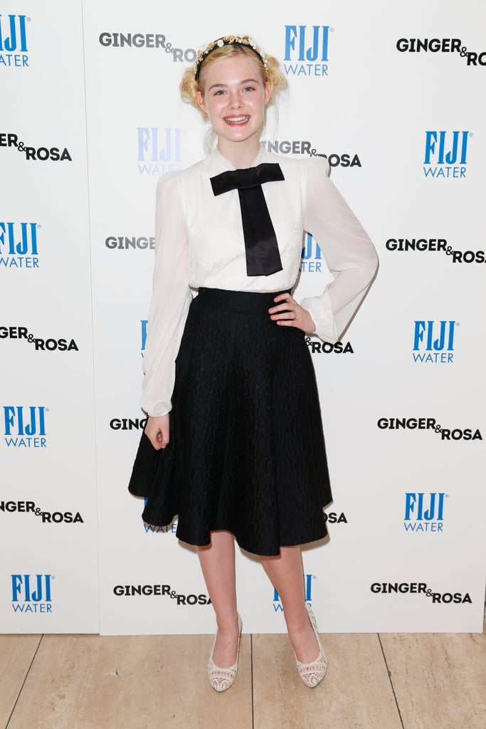 Elle Fanning posed for the cameras and the event put on by Fiji Water.