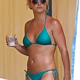 She went with a green bikini during her August 2010 vacation in Maui, HI.