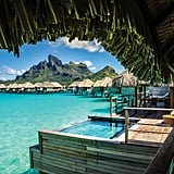 Stay at an overwater bungalow in Bora Bora.