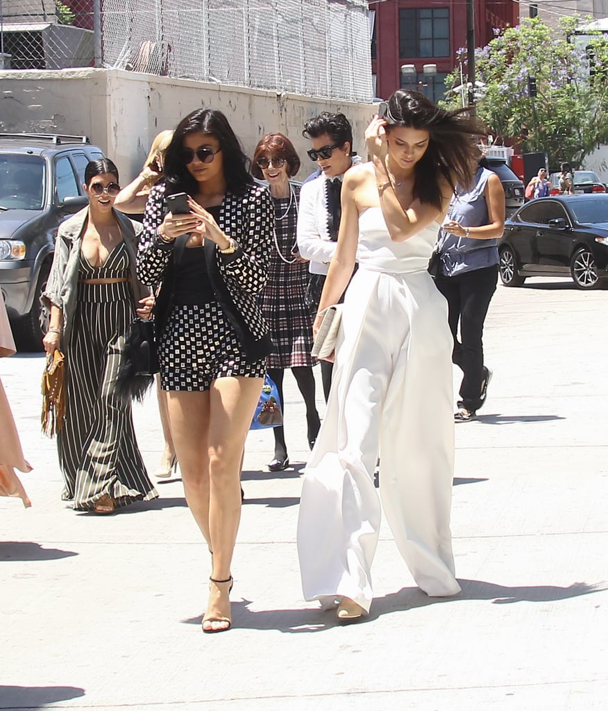 Kylie Jenner opted for a black and white printed suit set by Sass & Bide. She wore a gold watch, black ankle-strap Stuart Weitzman sandals, and a small black bag that she adorned with a furry Fendi key chain.