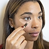 """While we like to blend concealer using our fingers, the best makeup brush to buy is flat with densely packed bristles. A dome-shaped tool like the Sigma Beauty F65 Large Concealer Brush ($21) will help you get into the smallest crevices.  If you want to erase tired, sagging eyes, there's an important product you have to apply even before concealer — corrector. While your concealer product will even out your dark circles to match your skin tone, a corrector brightens the entire area by neutralizing the blue or green undertones. """"Correctors come in peach or bisque tones,"""" Bobbi Brown makeup artist Kim Soane explained. """"The peach color eliminates gray and green, and bisque (or pink) takes away a gray/blue/purple under-eye.""""   You've probably been dotting concealer on in a half-moon shape for years, but an inverted triangle is the better strategy. Not only does it help draw attention upward toward the eye, but it also helps sculpt out the cheekbones. Make sure to extend concealer all the way to the inner corner of the eye."""