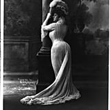 Bianca Lyons shows off her corseted curves in 1902.