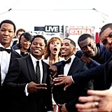 Susan Sarandon photobombed the cast of Straight Outta Compton on the 2016 red carpet.