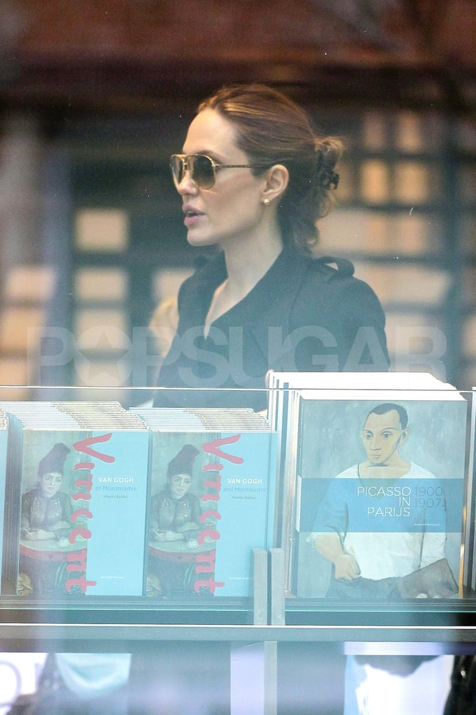 Angelina Jolie perused a book stand.