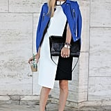 Joanna Hillman added interest to a white and black sheath with a bold, blue-hued leather topper and a pair of seriously cool Fall ankle boots.