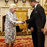Six-foot-tall David Beckham still towers over the queen when he bows.