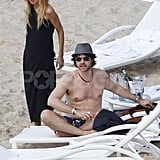Rachel Zoe stood next to shirtless Rodger Berman on the beach.