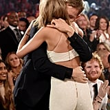 At May's Billboard Music Awards in Vegas, Taylor and Calvin took their relationship to the next level, sitting beside each other for their first official event together. Both musicians took home awards, and each time Taylor won, Calvin gave her a big hug, at one point giving her a kiss on the cheek.
