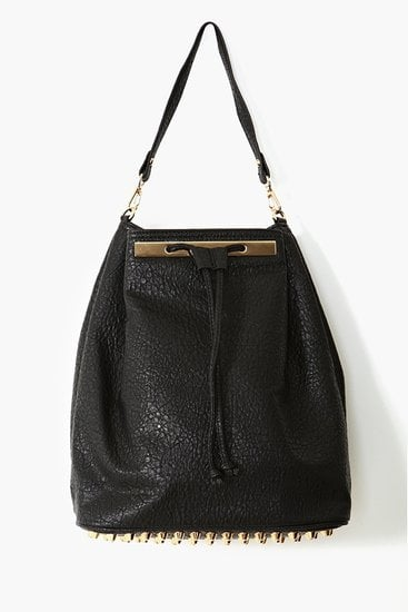 Luxe black vegan leather and gold hardware make this Nasty Gal Studded Backpack ($58) look a lot more expensive than it actually is.