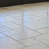 The house is perfectly laid with creme limestone floors.