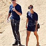 Ryan Gosling hikes with a clog-wearing Eva Mendes.