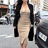 On May 21, Kim topped off a suede strapless dress with an overcoat. We imagine she was nice and toasty in the 66-degree temperatures.