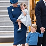 Even though Kate was holding Charlotte, she couldn't help but smile at George.