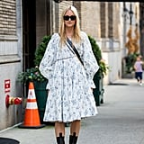Bring your hemline and boot height closer and closer with a midi dress and higher mid-calf chunky boots to style with.