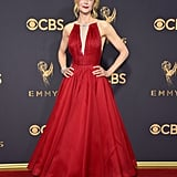 Nicole wearing a red Calvin Klein dress with mismatched heels at the 2017 Emmys.