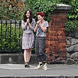 Lily Collins and Jamie Winstone had a laugh on the set of Love, Rosie in LA on Wednesday.