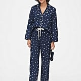 Help her channel extreme Winter vibes in this snowflake-covered Flannel Pajama Set ($70).