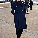 Outside Lincoln Center, the always-chic Olivia layered up with a military-style coat.