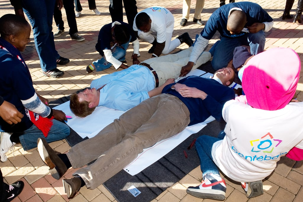 During their June 2010 visit to Lesotho, William and Harry took part in a game in which they had their bodies outlined and then wrote down their future wishes with a group of kids.