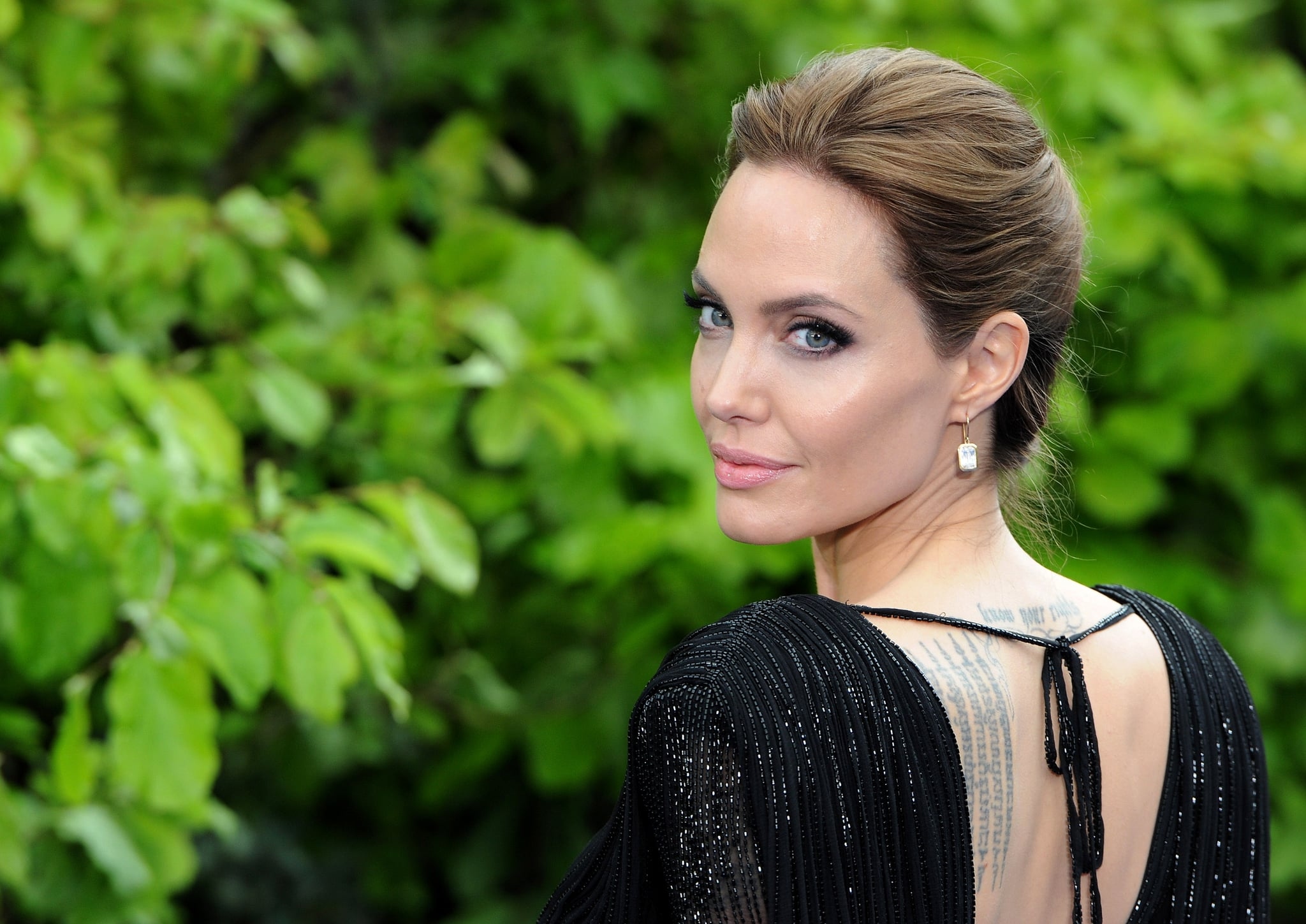 LONDON, ENGLAND - MAY 08:  Angelina Jolie attends a private reception as costumes and props from Disney's