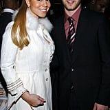He posed with Mariah Carey at the Rock and Roll Hall of Fame ceremony in March 2005.