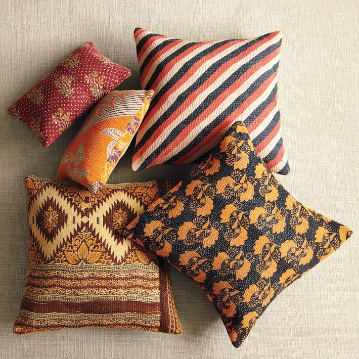Get the look of Paula's vibrant throw pillows by mixing and matching these Kantha Quilted Pillows ($19-$24).