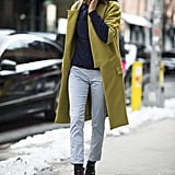 Hanneli Mustaparta kept it cool and classic in a pair of cropped, printed trousers and an understated but richly hued coat. Source: Le 21ème | Adam Katz Sinding