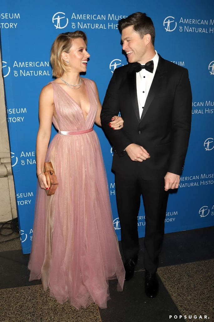 We don't get to see Scarlett Johansson and Colin Jost out together very often, but when we do, it's certainly a treat. On Thursday, the pair looked picture-perfect when they stepped out for the American Museum of Natural History Gala in NYC. Scarlett dazzled in a beautiful pink gown, while her other half suited up in a black tux. The couple appeared to be in a good mood as they walked arm in arm on the red carpet and exchanged loving looks. The museum benefit likely holds a special place in Scarlett and Colin's heart, as it's where they made their public debut as a couple last year. Also on hand for the event were Colin's Saturday Night Live costars including Pete Davidson, Leslie Jones, Aidy Bryant, and Kate McKinnon.  Scarlett and Colin were first linked together back in May 2017, but it wasn't until six months later that they seemingly confirmed their romance with a passionate makeout session in NYC. The last time we saw these two out together was at the Emmys in September.       Related:                                                                                                           Scarlett Johansson and Colin Jost Were Friends For a Decade Before They Started Dating