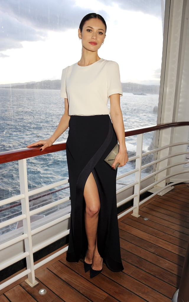 While aboard a yacht in Antibes, France, Olga Kurylenko was part sexy, part sophisticated in a white silk tee and a black maxi skirt with a dramatic front slit.