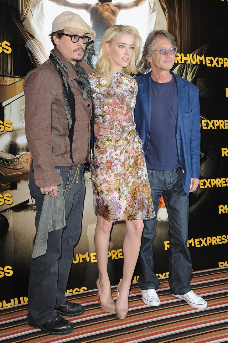 Johnny and Amber snapped a photo with their director Bruce Robinson.