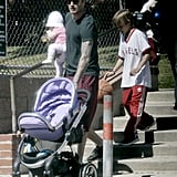 David Beckham watched daughter Harper Beckham and his sons.