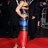Ruth Wilson smoldered in a body-hugging silk evening dress and sculpted heels from Dior Haute Couture on the Saving Mr. Banks red carpet.