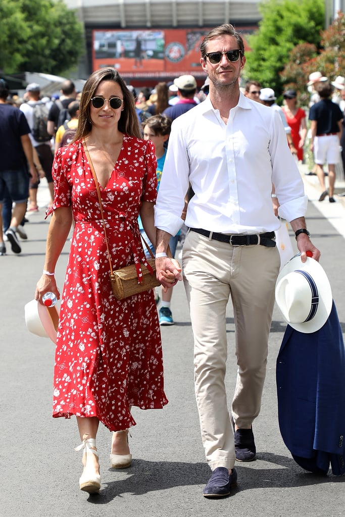 Love was in the air at the French Open in Paris thanks to Pippa Middleton and James Matthews. The couple, who tied the knot last May and are reportedly expecting their first child later this year, took to the streets holding hands and later watching the game for a picture perfect day date. Pippa and James were all smiles as the mom-to-be gave a glimpse of her growing baby bump underneath a flowy red Ralph Lauren dress. Their appearance comes one week after attending Prince Harry and Meghan Markle's royal wedding last Saturday. Keep reading to see more photos of their PDA-filled outing that will make your heart swoon.