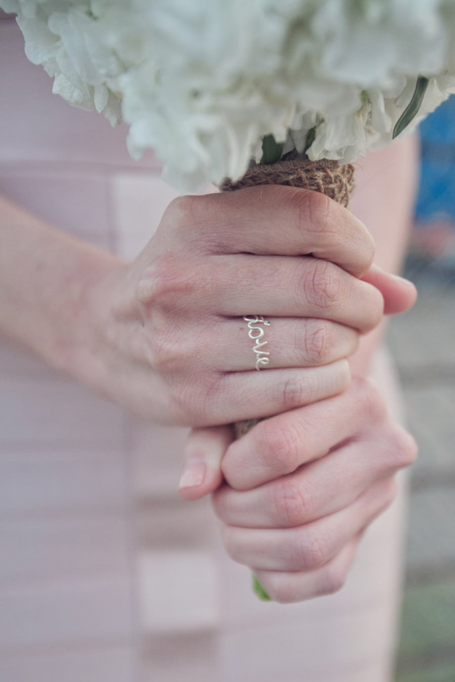 32. Ring While Holding Bouquet