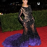 Beyoncé turned quite a few heads upon arriving at the Met Gala in this sheer, lace, feathered Givenchy gown. It was her first red-carpet appearance since giving birth to Blue Ivy, and we have to admit, she looked amazing.
