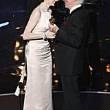 Anne Hathaway accepted her award from Christopher Plummer.