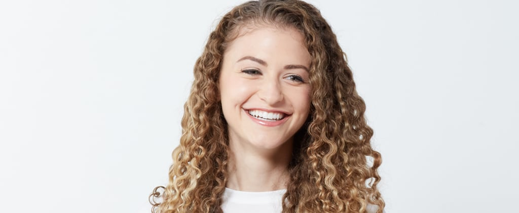 The Right Way to Use Dry Shampoo on Curly Hair