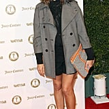 Rashida Jones layered a cool oversize coat with an LBD and chunky black ankle boots.